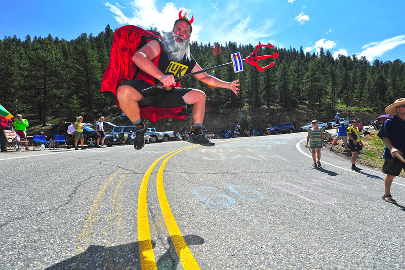 A cycling fan dressed as perhaps the most famous cycling fan in the world, Didi the Devil, on the Glen Haven Switchbacks on Saturday. The USA Pro Cycling Challenge churned quickly through Estes Park on it's sixth stage from Loveland to Fort Collins.