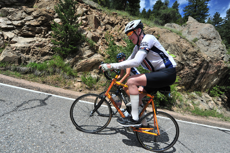 Former NBA star and cycling enthusiast Bill Walton grinds up the Glen Haven Switchbacks ahead of Saturday's stage 6 pass through Estes Park.