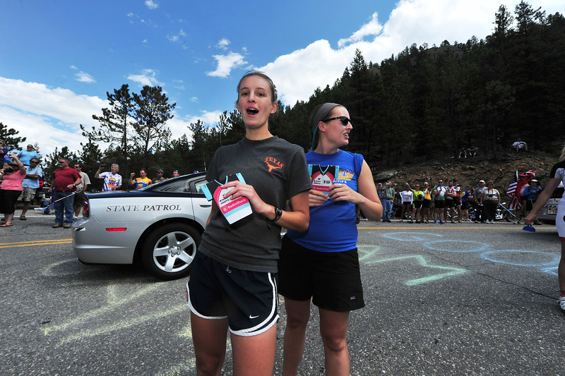 Fans cheer as the Colorado State Patrol brings up the rear of the race caravan at the Glen Haven Switchbacks on Saturday.