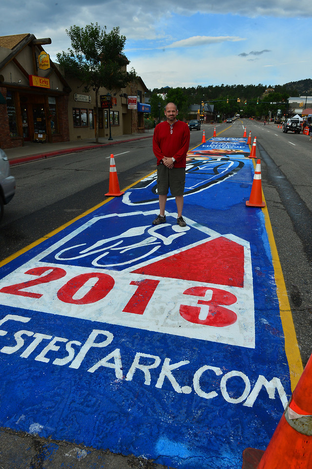 Local artist Michael Young stands with his creation on Elkhorn Avenue on Saturday Morning.