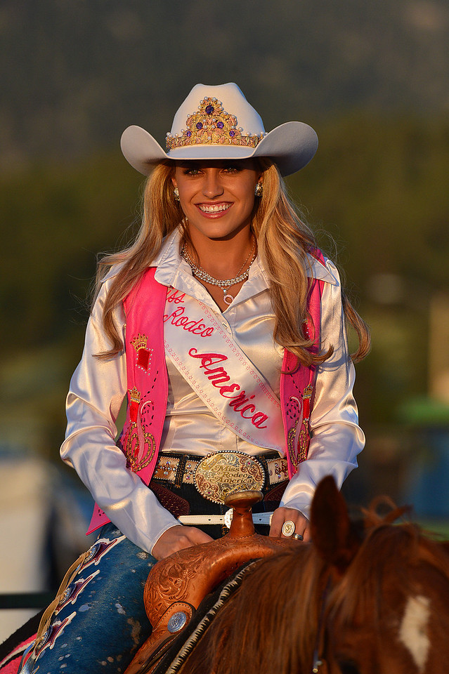 "Miss Rodeo America, Chenae Shiner, watches the sunset last Thursday at the Rooftop Rodeo. The ""First Lady of Rodeo"" is crowned every December at the National Finals Rodeo in Las Vegas, Nevada."