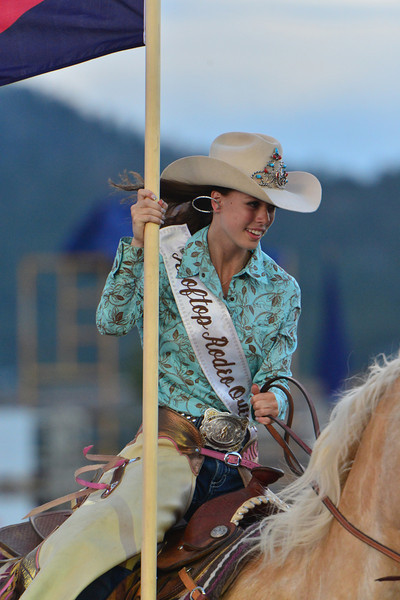 Rooftop Rodeo Queen Michelle Claypool races around the Stanley Fairgrounds arena with the state flag on Saturday. Rodeo royalty does so much more than just stand around and look pretty, as they are ambassadors of the sport and their individual rodeos.