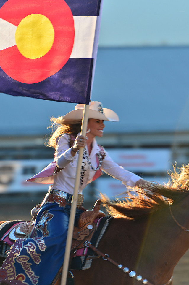 Miss Rodeo Colorado, Sarah Faith Wiens, carries the state flag around the rodeo arena last week. Weins is a third generation cowgirl from Sedalia.