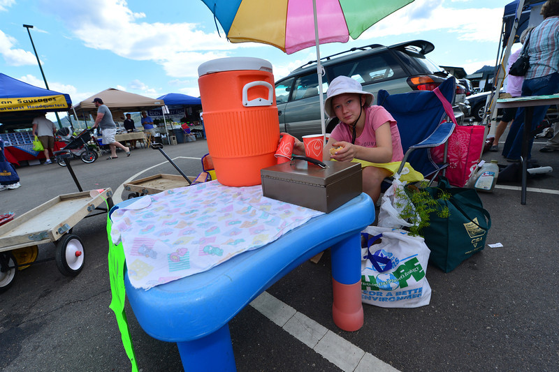 Annalice Basch sells lemonade at the Estes Valley Farmers Market.