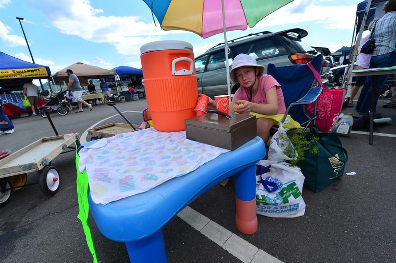 Annalice Basch sells lemonade at the Estes Valley Farmers Market.