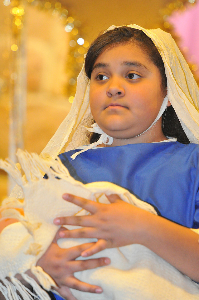 Jeniffer Salinas portrays the Mary in the Christmas Pageant on Sunday. The portrail of Mary is signified by the blue dress.