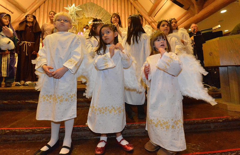 The littlest angels wait for direction in the Christmas Pageant on Sunday. The children range in age from kindergarten through fifth grade in the acting out of the Christmas story.