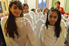 Young angels Ayla Navaro, 10, and Gina Luna Rascon, 10, lead agels out of their classroom before Sunday's performance. Children from the church grow up playing parts in the annual pageant.