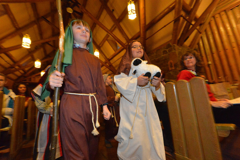 Gabe Housewrite, 8, right, and Emanuel Acosta Navas, 8, lead the shepherds into the sactuary at Our Lady of the Mountains Catholic Church on Sunday. The annual Christmas Pageant is an event children and parents look forward to every year.