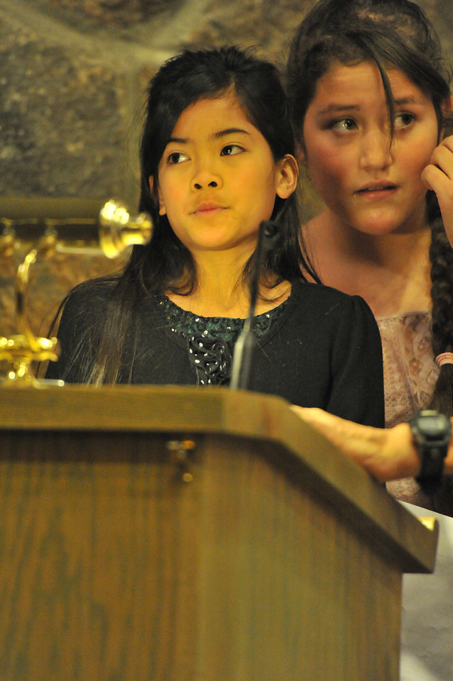 Samantha Daley, left, and Paulina Tapia narate the Christmas story on Sunday. Some children are more comfortable speaking rather than acting in the pageant.