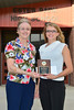 Karin Kingswood receives $1,000 from Estes Park town trustee Wendy Koenig for the Student Pride Award.
