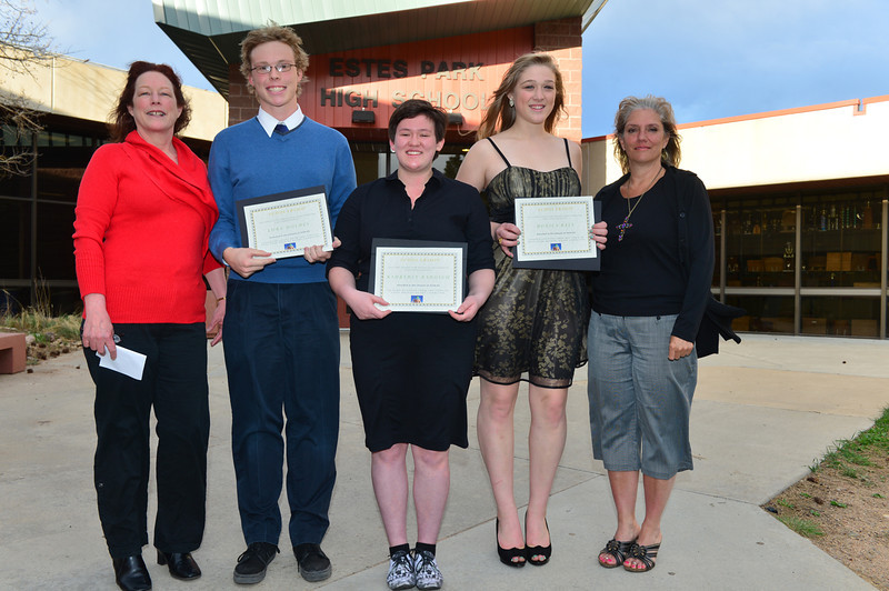 Luke Holmes, Kimberly Barosh and Monica Ball each receive $650 from Jan Carpenter and Penni Barnes of the Town of Estes Park Helping Hands Scholarship.