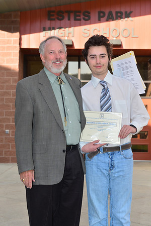 Collin Fogarty receives $1,000 from Marvin Hart representing the Estes Park Masonic Lodge.
