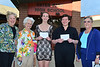 Sierra Dennis and Kim Barosh each receive $2,000 from Delphine Casey, Carol Smith and Ginny Thompson representing the Estes Park Woman's Club.