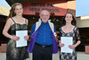 Monica Ball and Sierra Dennis each receive $500 and Ireland Reiner (not shown) receives $1,000 from Allen Settje of the Lions Club.