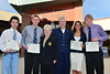 Collin Fogerty, Austin Severin, Annette Cernac and Peter Van Horn each receive $2,500 from Jo Jones and CJ Jenson of the Longs Peak Rotary Club.