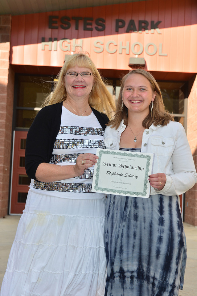 Stephanie Soliday receives $2,000 from Brenda Reins representing the Fine Arts Guild of the Rockies.