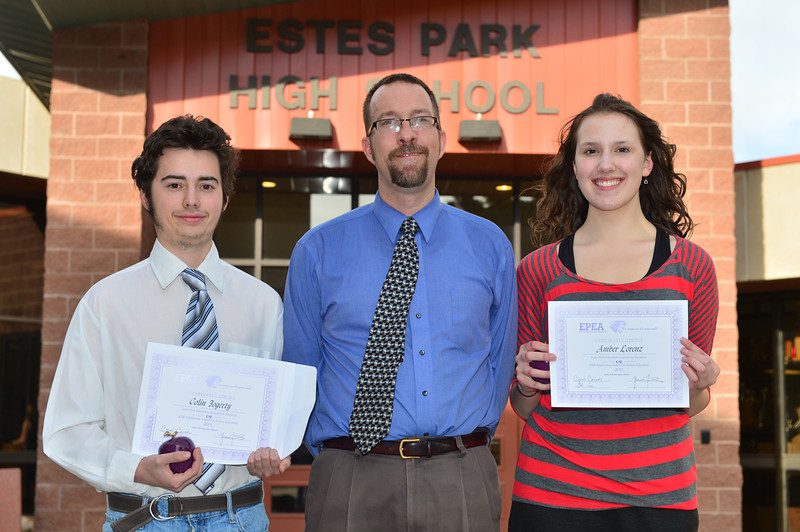 Collin Fogerty and Amber Lorenz each receive $500 from Glenn Case representing the Estes Park Education Association.
