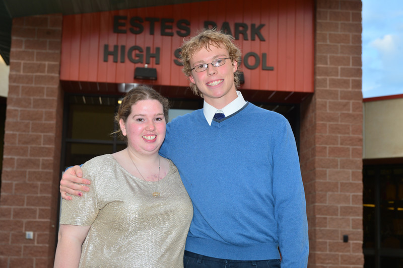 Lindsey Marquez and Luke Holmes each receive $500 from the Ace Hardware of Estes Park.