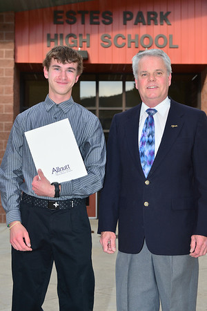 Timothy Brown receives $1,000 from Bill Smith representing the Allnutt Family scholarship.