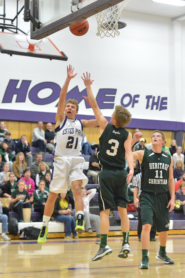 Chris Moody scores for the 'Cats. The Bobcats dropped the game against Heritage Christian, 111-109, in triple-overtime.
