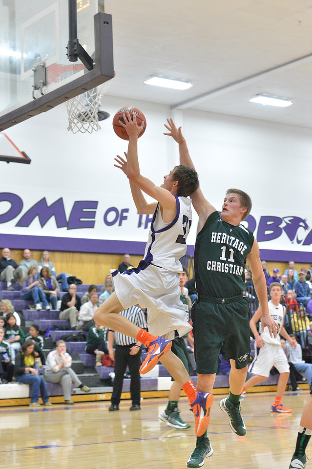Ben Cirone goes up for two of his 23 points against Heritage Christian on Tuesday. The Bobcats dropped the game against Heritage Christian, 111-109, in triple-overtime.
