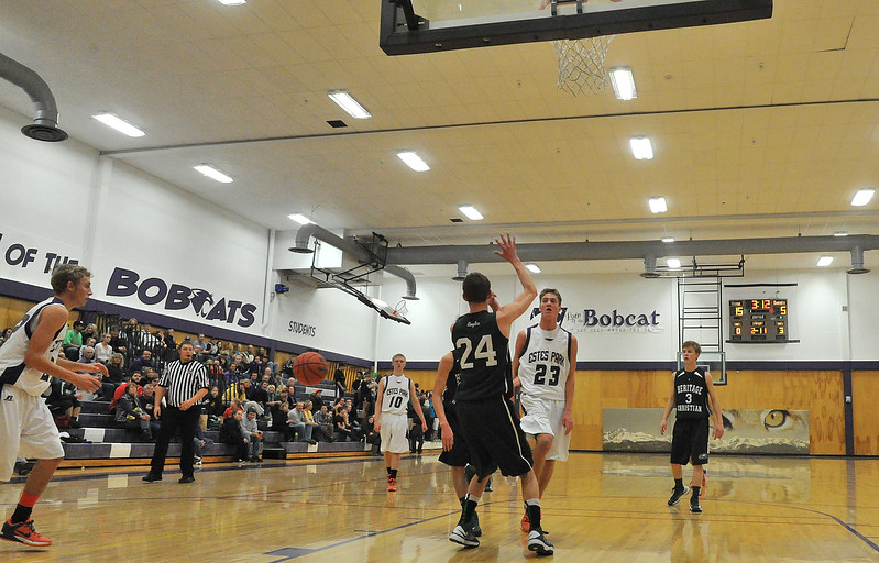 Isaak Cirone dishes off a no-look pass to brother Andrew in the first quarter of the Bobcats' Tuesday night game. The Bobcats dropped the game against Heritage Christian, 111-109, in triple-overtime.