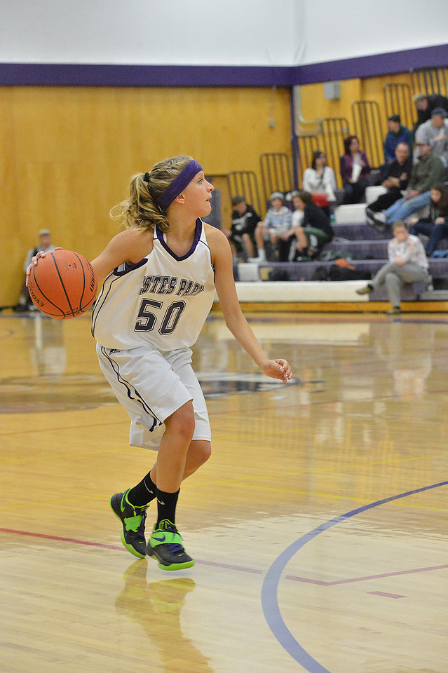 Co-captain Karin Kingswood drives the offense late in the fourth quarter of Tuesday night's game. The Ladycats earned their fifth win of the season, blowing out Heritage Christian 50-31.