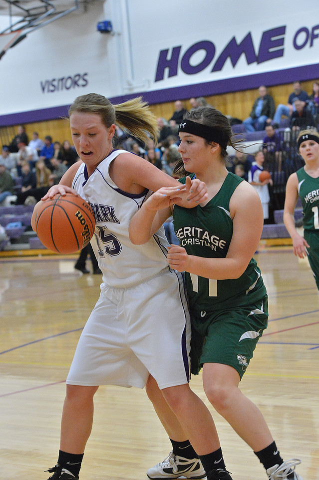 Estes Park's Becky Reilly holds off an Eagles defender on Tuesday night. The Ladycats earned their fifth win of the season, blowing out Heritage Christian 50-31.