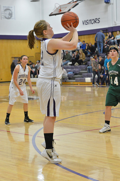 Sophomore Sarah Kozlowski takes a shot on Tuesday night. The Ladycats earned their fifth win of the season, blowing out Heritage Christian 50-31.