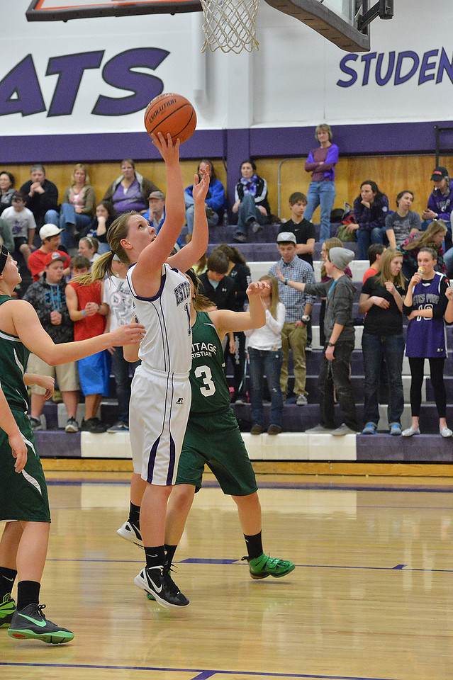 Becky Reilly puts in two of her total four points in the Ladycats' 50-31 blowout win on Tuesday. Reilly also had six rebounds and a blocked shot against the Eagles.