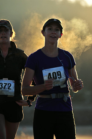 Runners create steam on the early stretches of the Rocky Mountain Half Marathon on Saturday. Air temperatures were just under 50 degrees when the race began at 6 a.m.