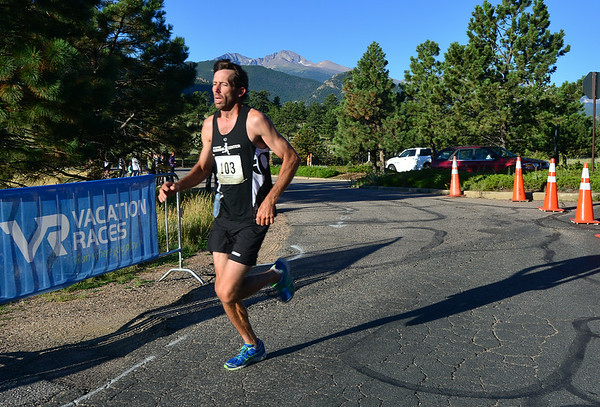 Walter Brown of Riverton, Utah, comes throught the final barracades for a course record and win of 1:22:11 on Saturday. The first three runners actually finnished under the course record time for the Rocky Mountain Half Marathon.