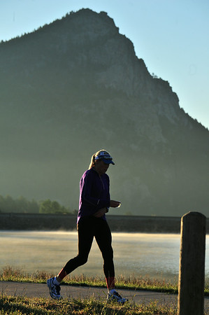 A competitor passes along Lake Estes in the shadow of Mount Olympus on Saturday. While the Rocky Mountain Half Marathon never enters the park, it showed off plenty of the views that make the race special.