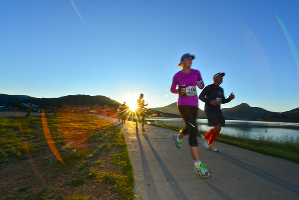 The sun rises over half-marathoners as they pass by the Lake Estes Marina during Saturday's race. The Rocky Mountain Half Marathon began before sunrise, leading to spectacular views throughout the race.