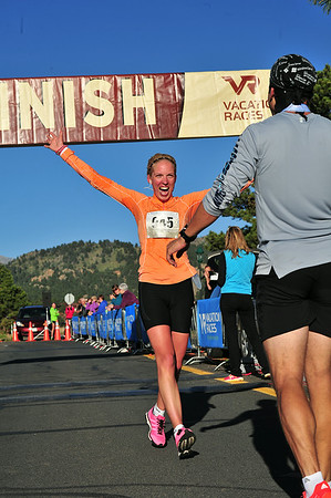 Hanka Randakova of Prague, Czeck Republic, is elated as she takes the women's title of the Rocky Mountain Half Marathon in 1:32:03. Countryman and hug recipient, Jan Knyttl, was second overall on the men's side.