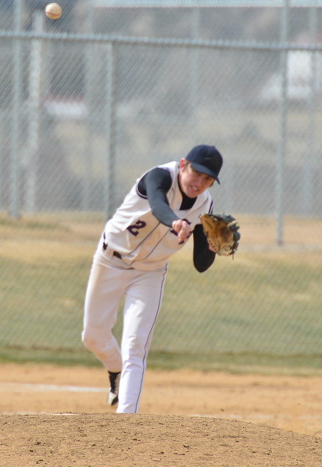 Adam Tulley unloads a fielded ball toward first base in game two against Highland on Saturday. The Bobcats' fielding is improving, but the Highland Huskies took both Saturday games.