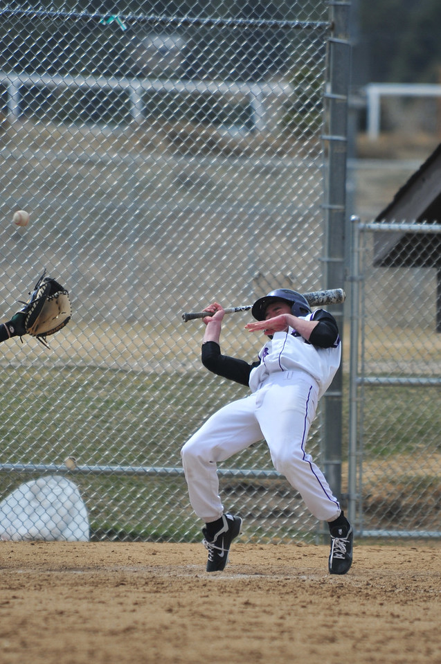 Estes Park batters had to be on their toes against the Highland pitchers. Close pitches and quick pick-off moves made life difficult for the Bobcat batters.