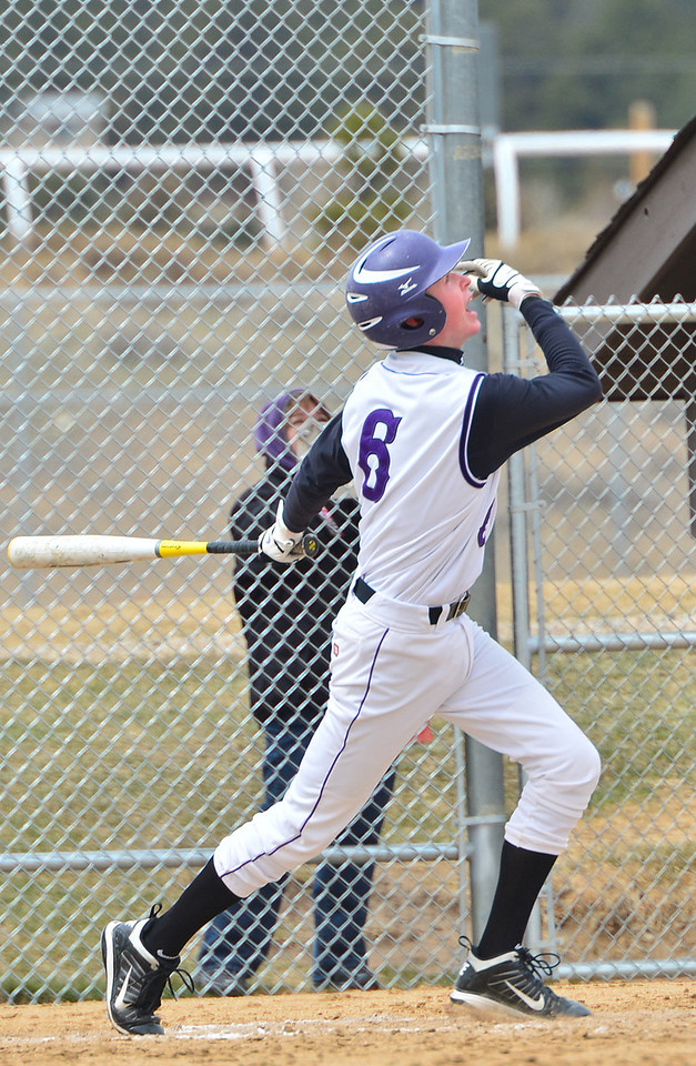 Dylan Jirsa knocks a hit out to left field against Highland on Saturday. Jirsa had a good showing in game two against the Huskies, with a single, a double, a triple, but only one RBI.