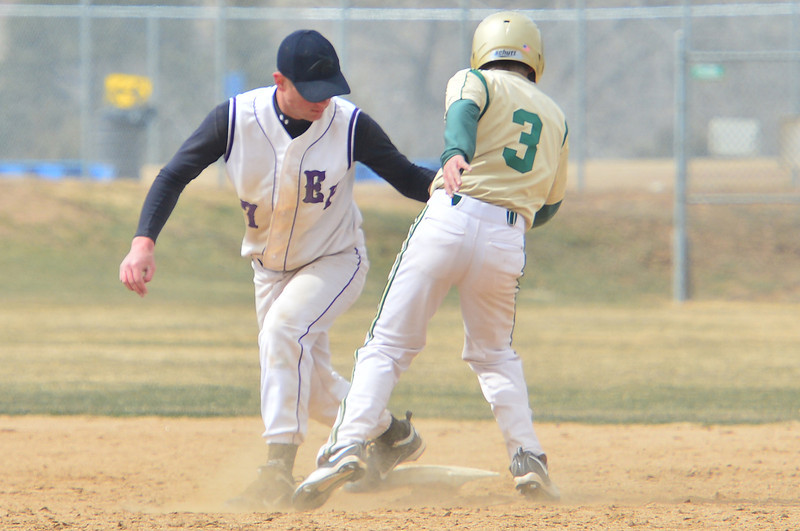 Cam Bogener tags out Highland's Jake Trujillo in game two of the Saturday doubleheader. Bogener played well at second base in game two after pitching game one against the Huskies.