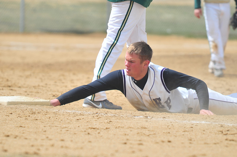 Cam Bogener sprawls for first base during a pick-off attempt during game two of Saturday's doubleheader against Highland. Bogener felt a little picked on during his visit to the bases as the Huskies' pitcher tried again and again to pick off Bogener on both first and second bases.