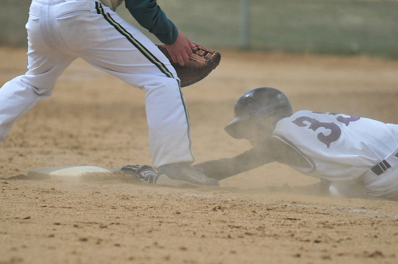 Logan Brown reaches for first base during game two of the team's doubeheader. When the dust settled, the Huskies took both games over the Estes Park team, 17-6 and 22-12.