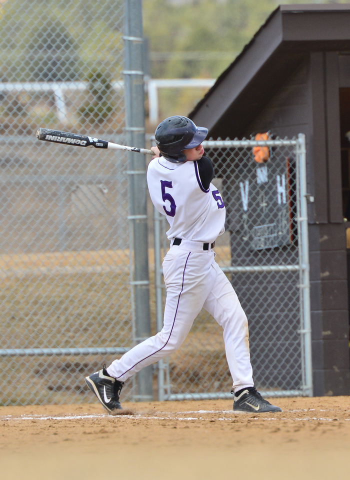Zach Louk sends a pitch back to the outfield against Clear Creek on Saturday. The Bobcats were ready to win afetr their weather-induced break last week.