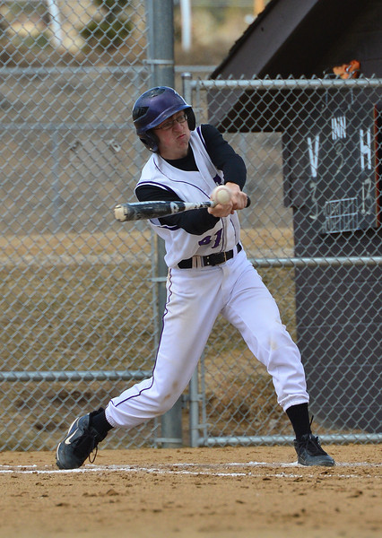 Alex Fraser swings away against the Clear Creek Golddiggers on Saturday. Estes Park notched a 16-3 win on Saturday.
