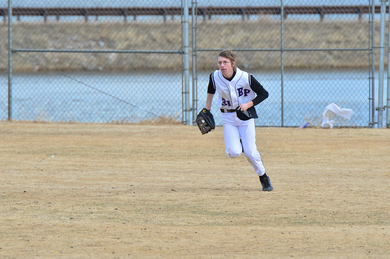 Alex Fraser runs in from the outfield after a third-out fly ball on Saturday. The Bobcats defeated the Clear Creek Golddiggers on Saturday, 16-3.