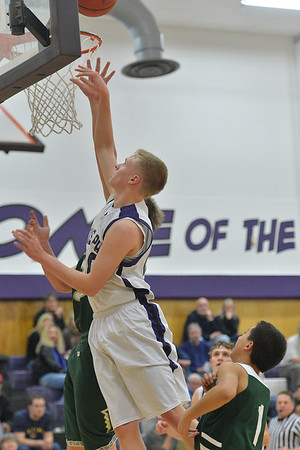 Taylor Marshall gets in close against Highland on Friday. Marshall led the 'Cats in scoring with 25 points.
