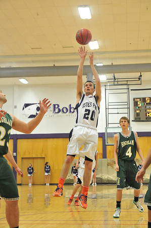 Josh Hays shoots from the top of the key against Highland on Friday. Hays had eight points and four assists.