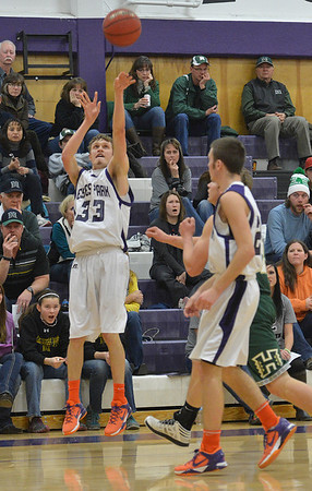 Ben Cirone shoots for three, to the dismay of Highland fans on Friday. Ben hit three three-point shots against the Huskies.