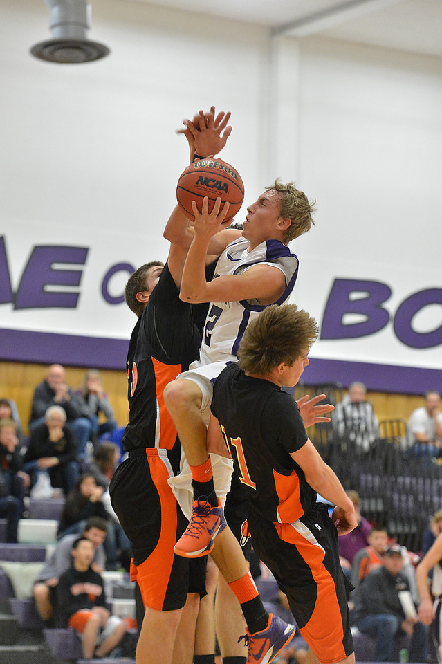 Andrew Cirone attempts to plow through the Sterling defense on Saturday. Cirone led the Bobcats in scoeing with 13 points, but could not put the team over as the lost to the visiting Tigers, 49-43.