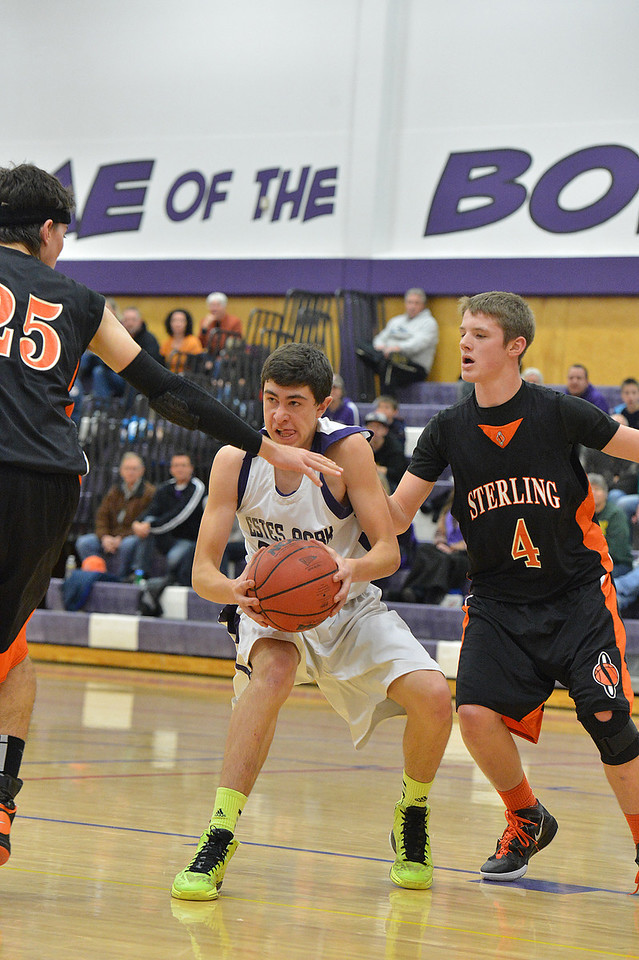 Jonathen Treat looks for a teammate against the Sterling Tigers on Saturday. The Bobcats suffered their fourth loss in a row in their Saturday game with the visiting Tigeres.